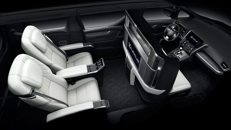 interior cabin view of the luxurious white reclining seats of a Lexus LM 300h