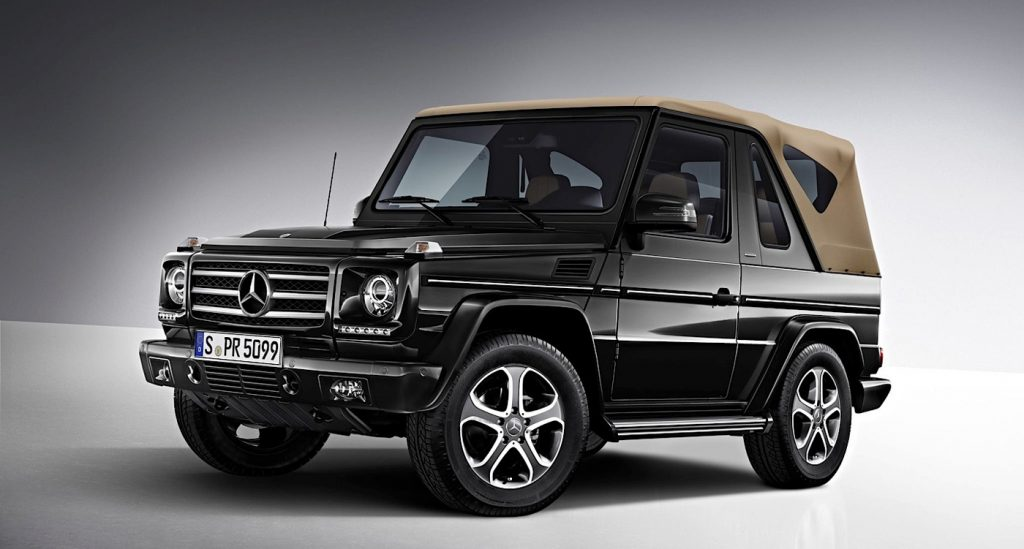 a black cabriolet g-wagon with a tan convertible top, press phot against a gray backdrop