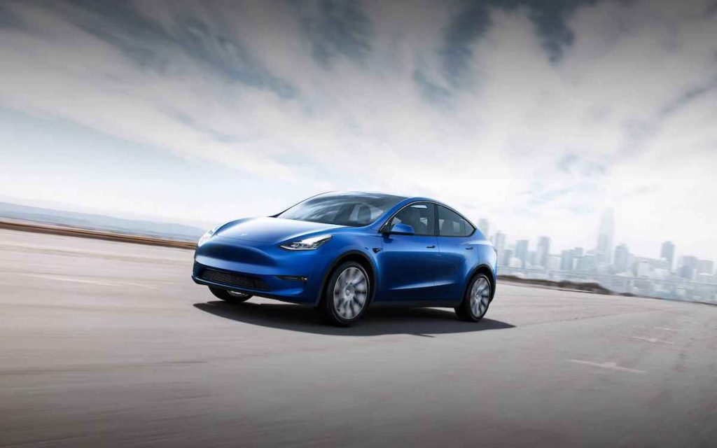 Blue Tesla Model Y Driving