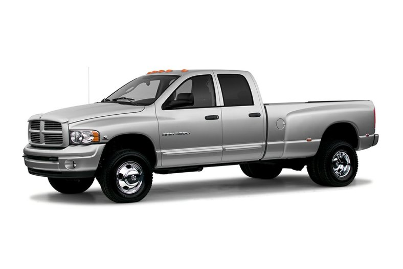 silver 2004 Dodge Ram 3500 heavy duty pickup truck press photo against a white backdrop