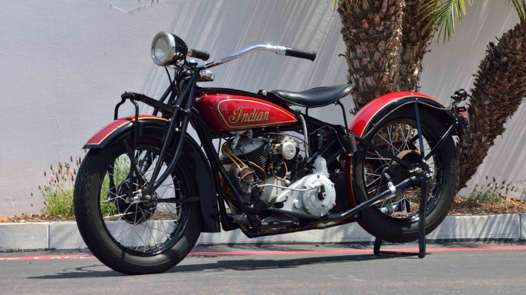 A black-and-red 1929 Indian 101 Scout on its rear-wheel stand