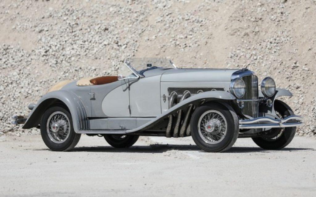 A gray 1935 Duesenberg Model SSJ in a quarry