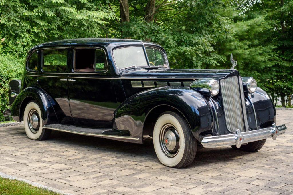 A dark-blue 1938 Packard Super Eight Touring Sedan