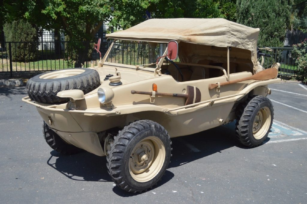 A tan 1944 Volkswagen Type 166 Schwimmwagen with its fabric roof up