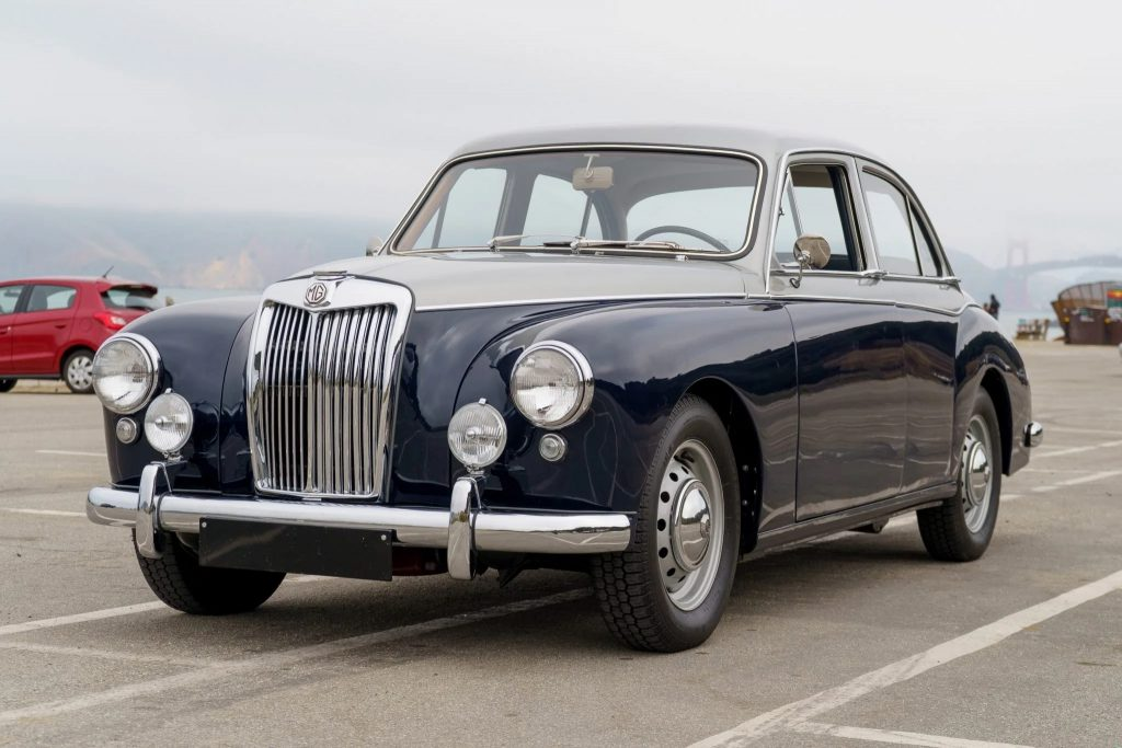 A blue-and-silver 1958 MG Magnette ZB Varitone by the sea