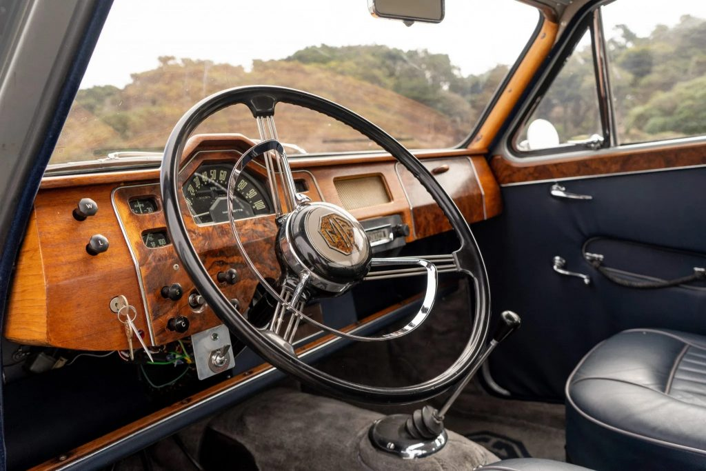 The real-wood dashboard and blue leather upholstery of a 1958 MG Magnette ZB Varitone