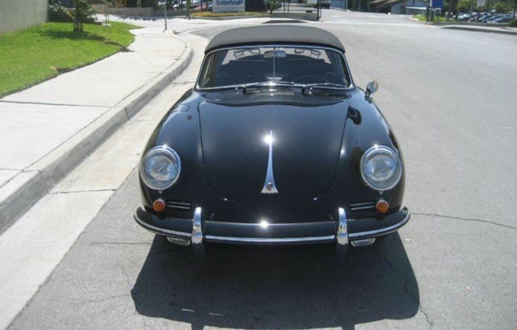 A head on view of a black 1965 Porsche 356 SC Cabriolet