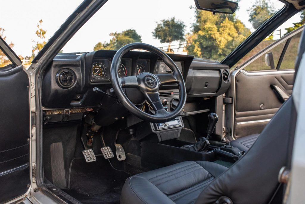 The black interior of a 1983 Alfa Romeo GTV6
