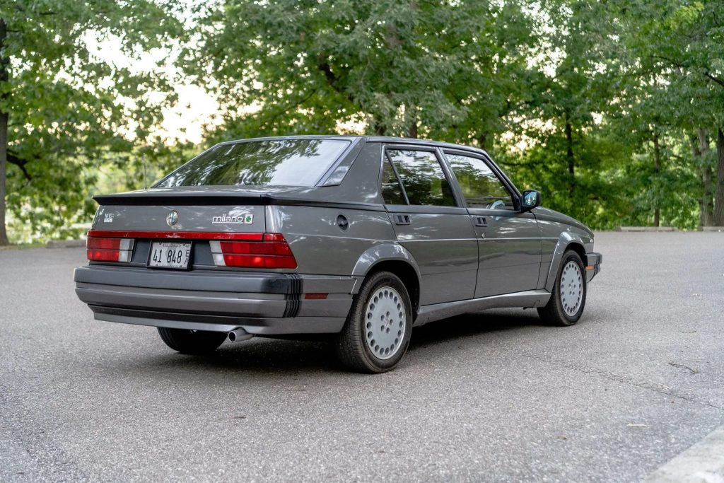 The rear view of a gray 1988 Alfa Romeo Milano Verde