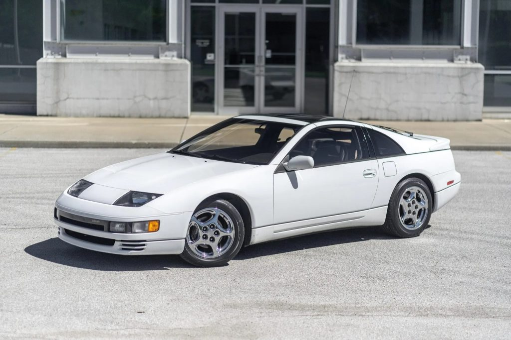 A white 1990 Nissan 300ZX Twin Turbo in front of an industrial building