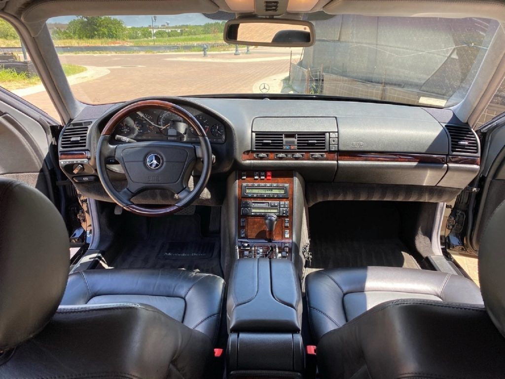 The black-leather-upholstered 1998 Mercedes-Benz W140 S600's interior
