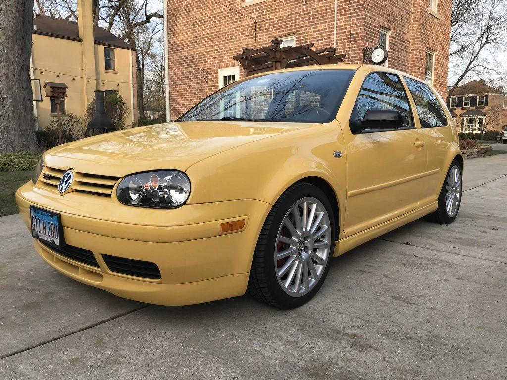 A yellow 2003 Volkswagen Golf GTI 20th Anniversary Edition