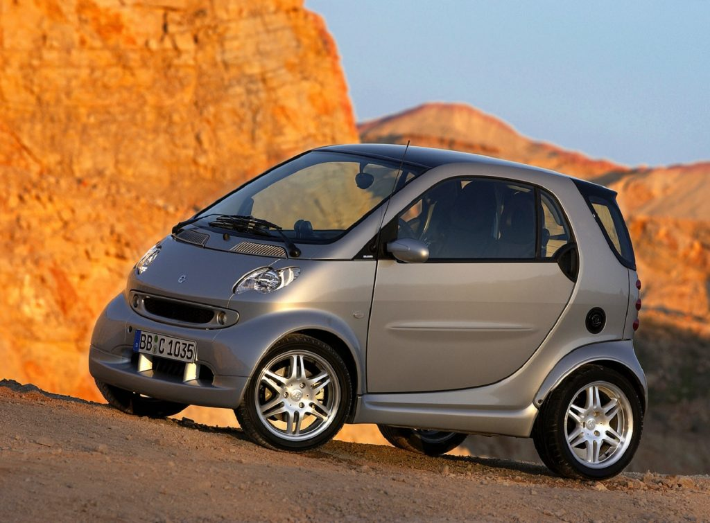 A silver 2005 Brabus Smart Fortwo in the desert