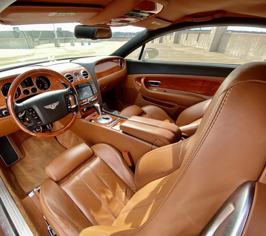 The tan-leather and wood-trimmed interior of a 2007 Bentley Continental GT