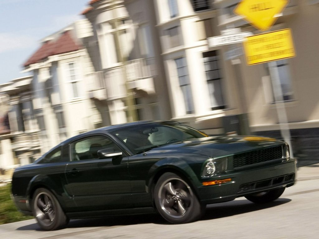 A dark green Ford Mustang prowls the streets of California