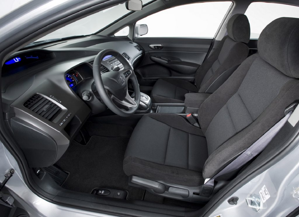 The 2009 Honda Civic's black front seats and dashboard