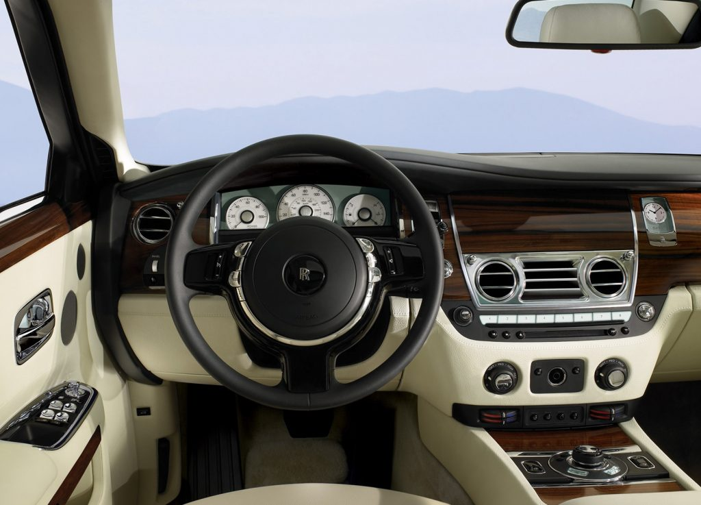 The 2010 Rolls-Royce Ghost's tan-leather and wood-trimmed interior