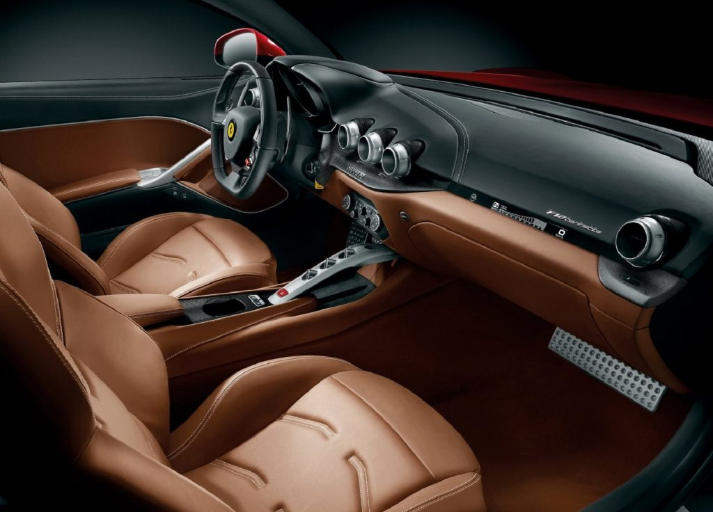 The tan-leather-upholstered interior of a 2013 Ferrari F12 Berlinetta