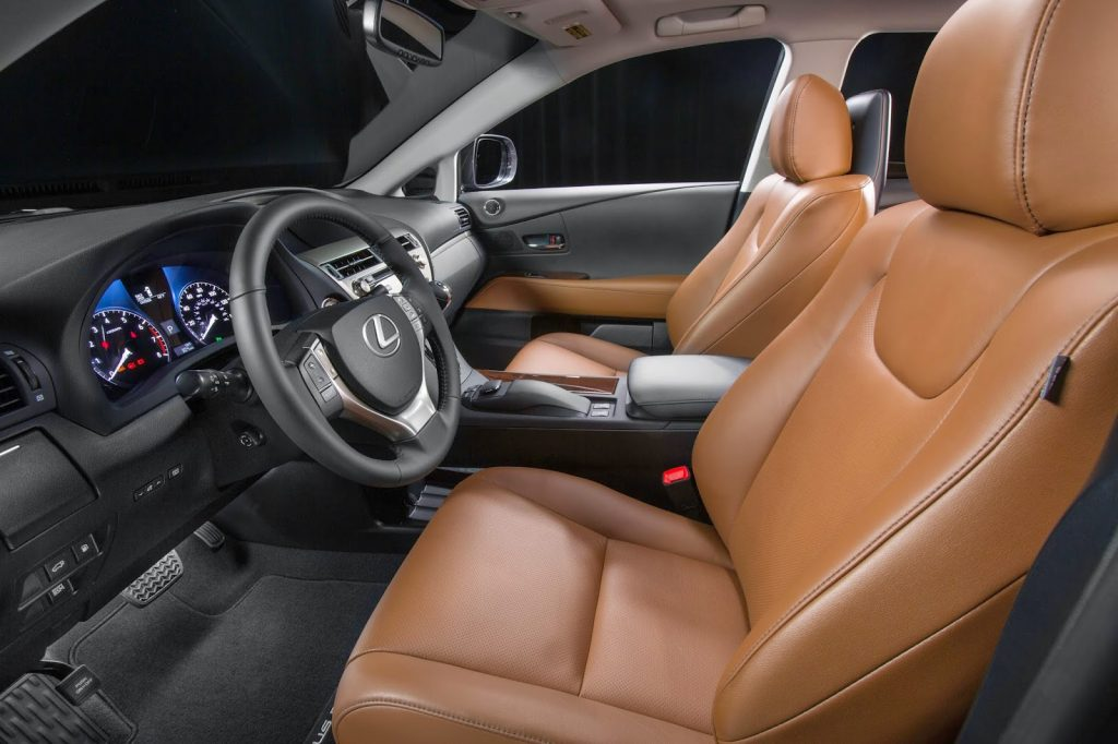 A 2015 Lexus RX with brown leather seats.