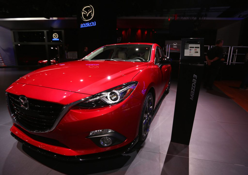 A 2015 Mazda3 on display at an auto show