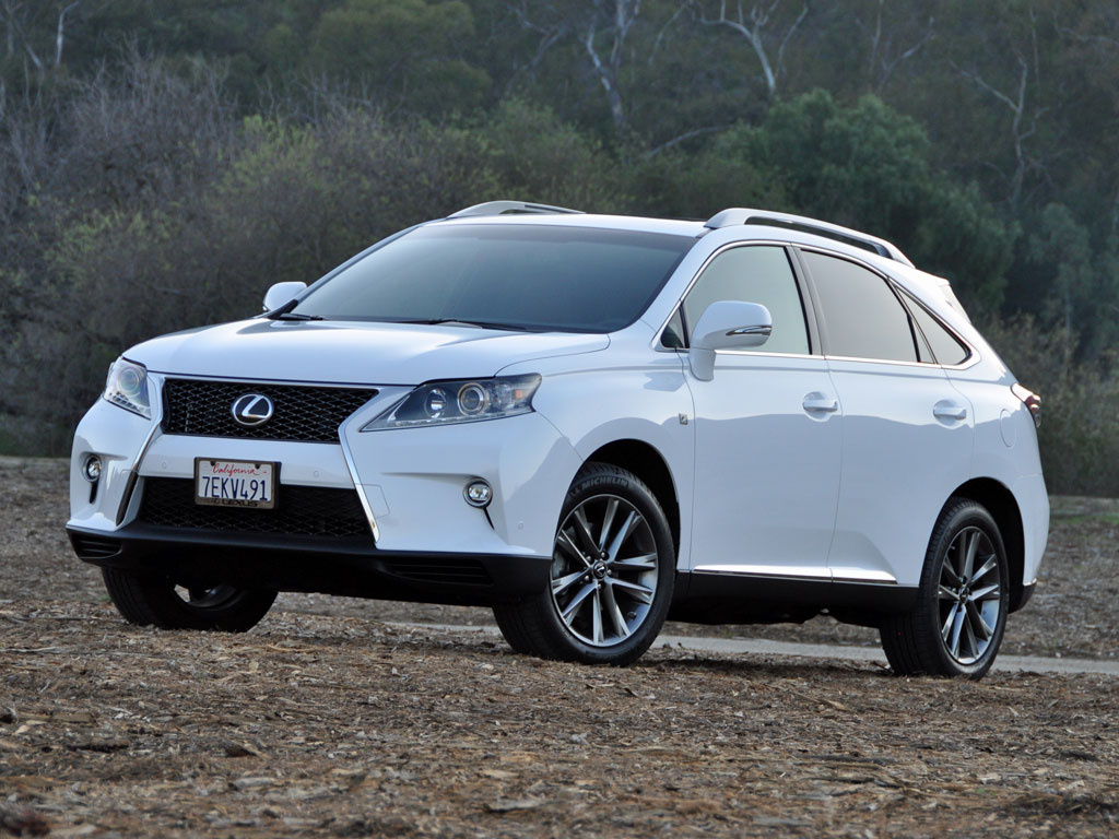 A white 2015 Lexus RX on the track.