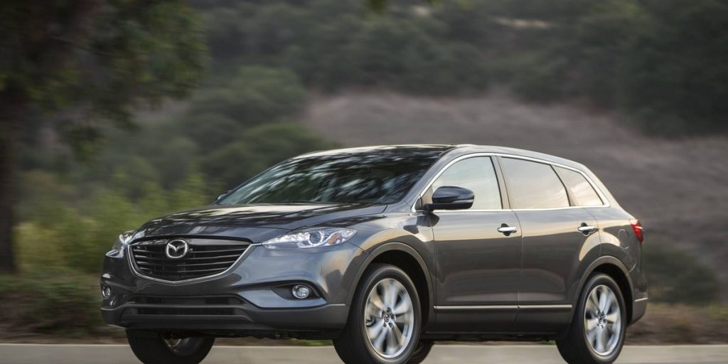 A grey 2015 Mazda CX-9 on the track.