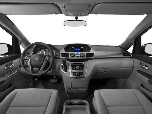 A 2015 Honda Odyssey with leather seats.