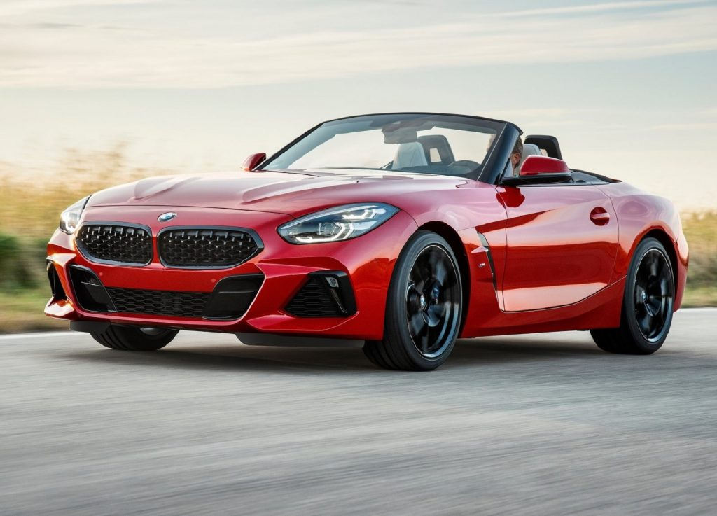 A red 2019 BMW Z4 M40i First Edition with its roof down