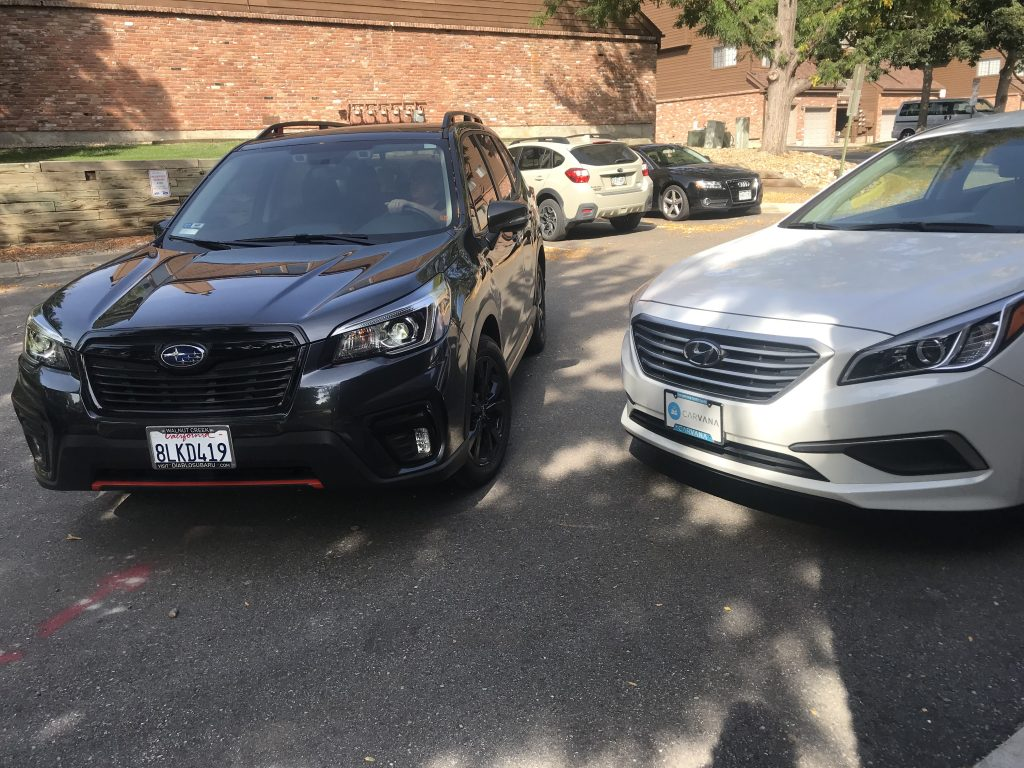 2019 Subaru Forester next to the Carvana car
