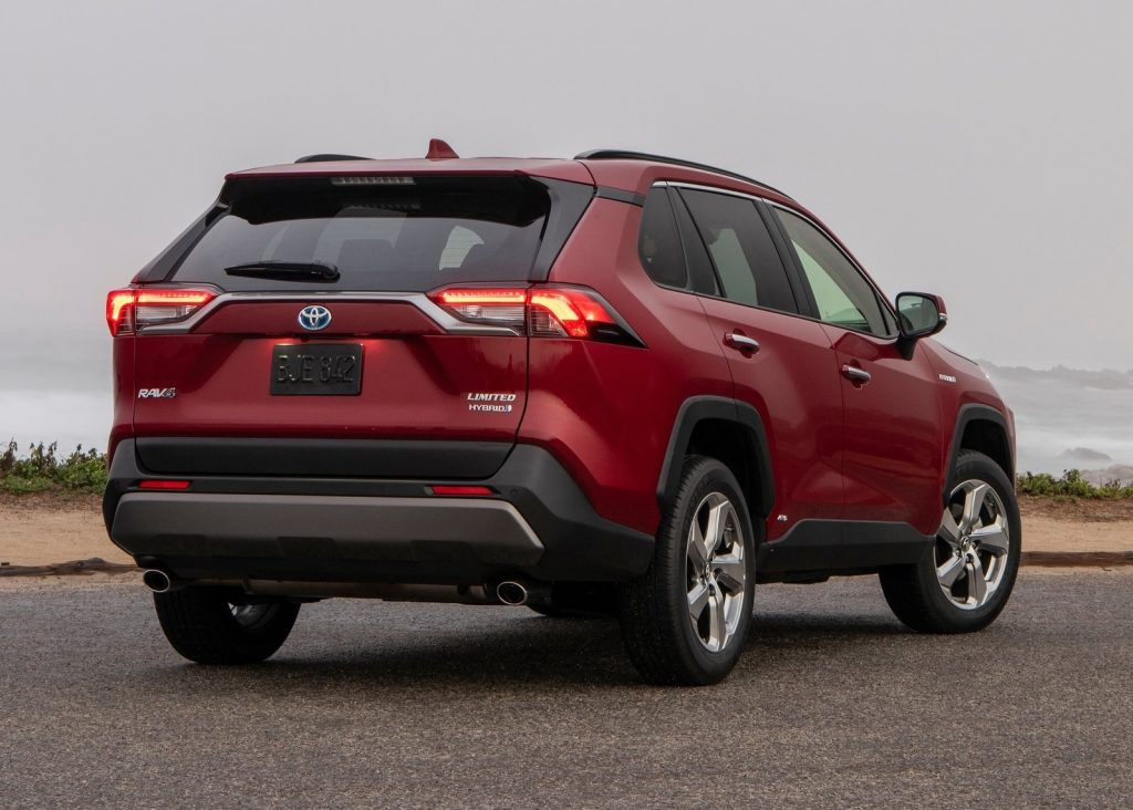 The rear of a red 2019 Toyota RAV4 Hybrid Limited on a foggy day
