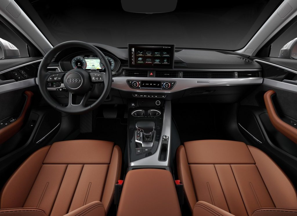 The brown-leather front seats and silver-and-black dashboard of the 2020 Audi A4