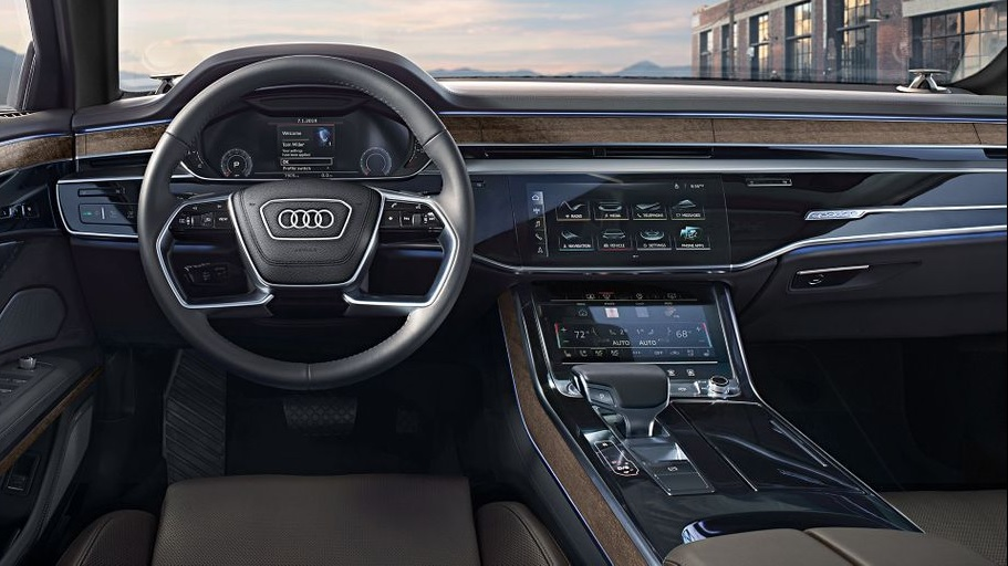 The leather-and-wood-trimmed center console of the 2020 Audi A8