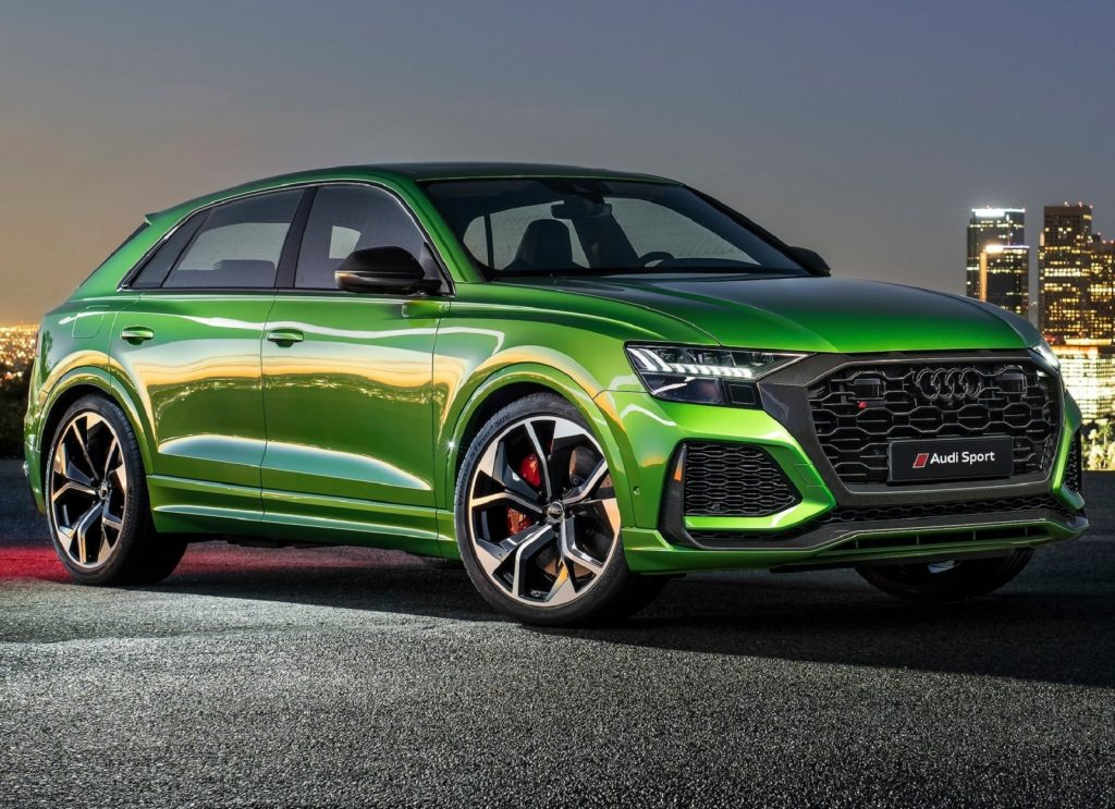 A green 2020 Audi RS Q8 front 3/4 in front of a city scene