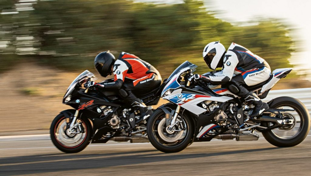 2 riders on a black and a white-red-and-blue 2020 BMW S 1000 RR