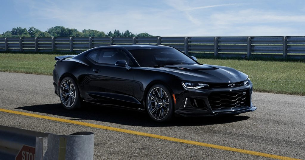 A black 2020 Chevrolet Camaro ZL1 parked on a racetrack