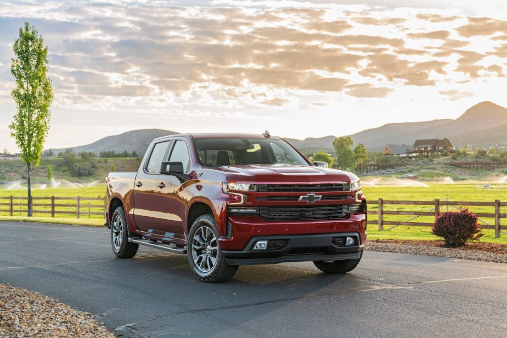2020 Chevrolet Silverado Diesel driving on a farm