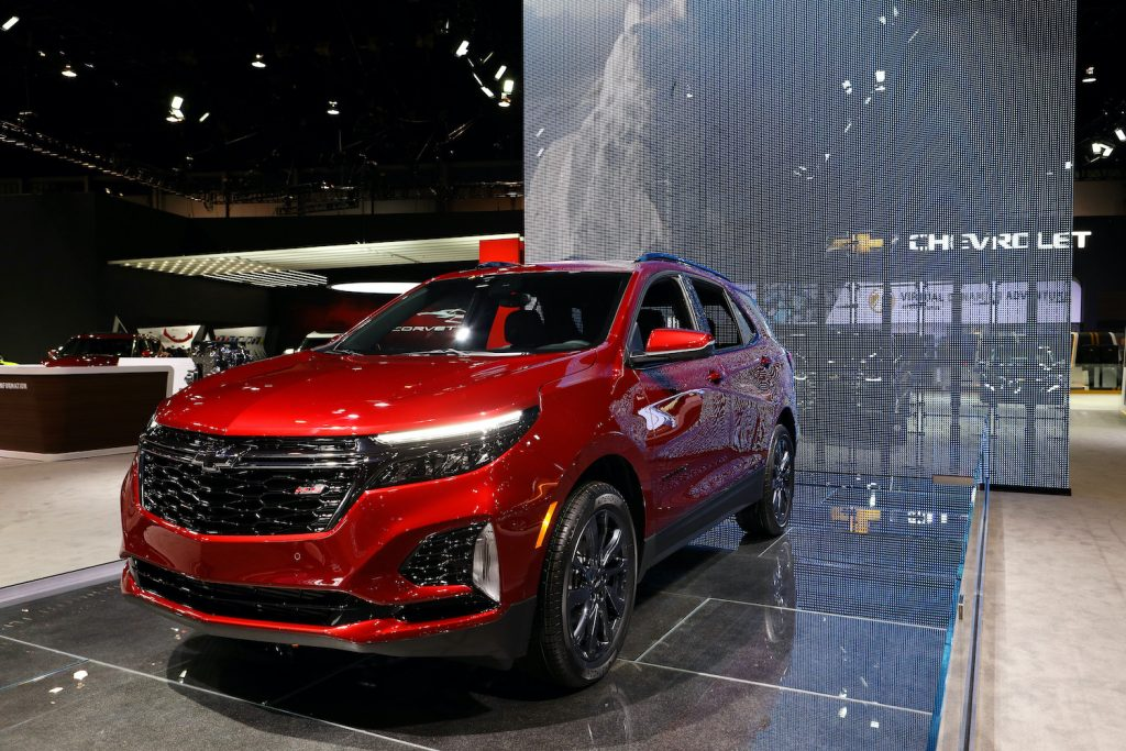 A Red 2020 Chevy Equinox on display at an auto show