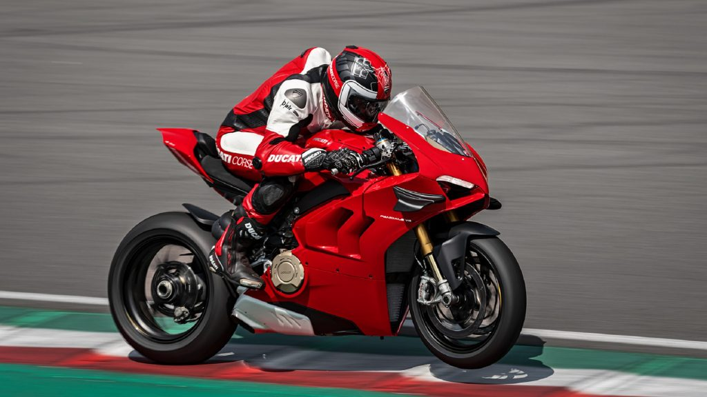 A rider on a red 2020 Ducati Panigale V4 S at the track