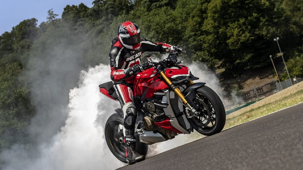 A rider does a burnout on a red 2020 Ducati Streetfighter V4 S