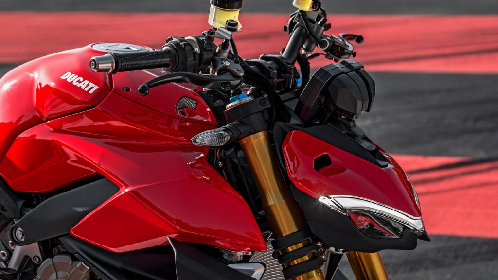 A close look at a red 2020 Ducati Streetfighter V4 S' handlebar and dash area
