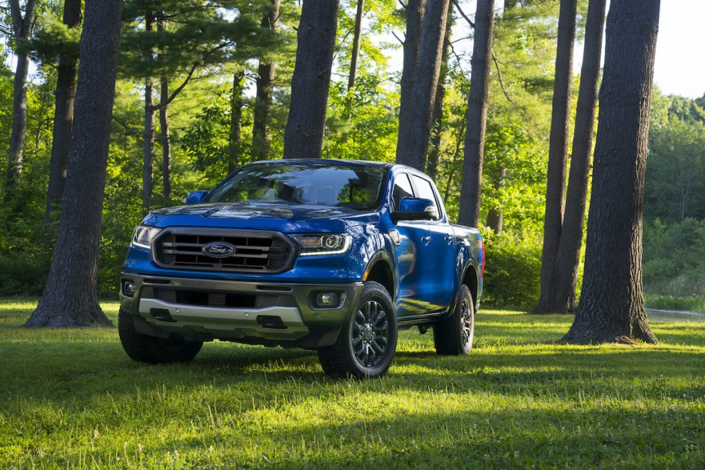 2020 Ford Ranger driving in the forest with lush green grass