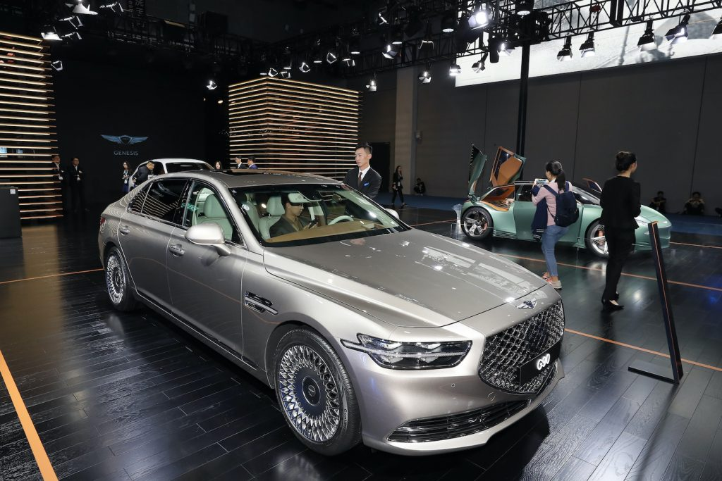 A silver 2020 G90 on display at an auto show