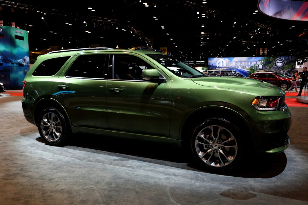 A green 2020 Dodge Durango on display at an auto show