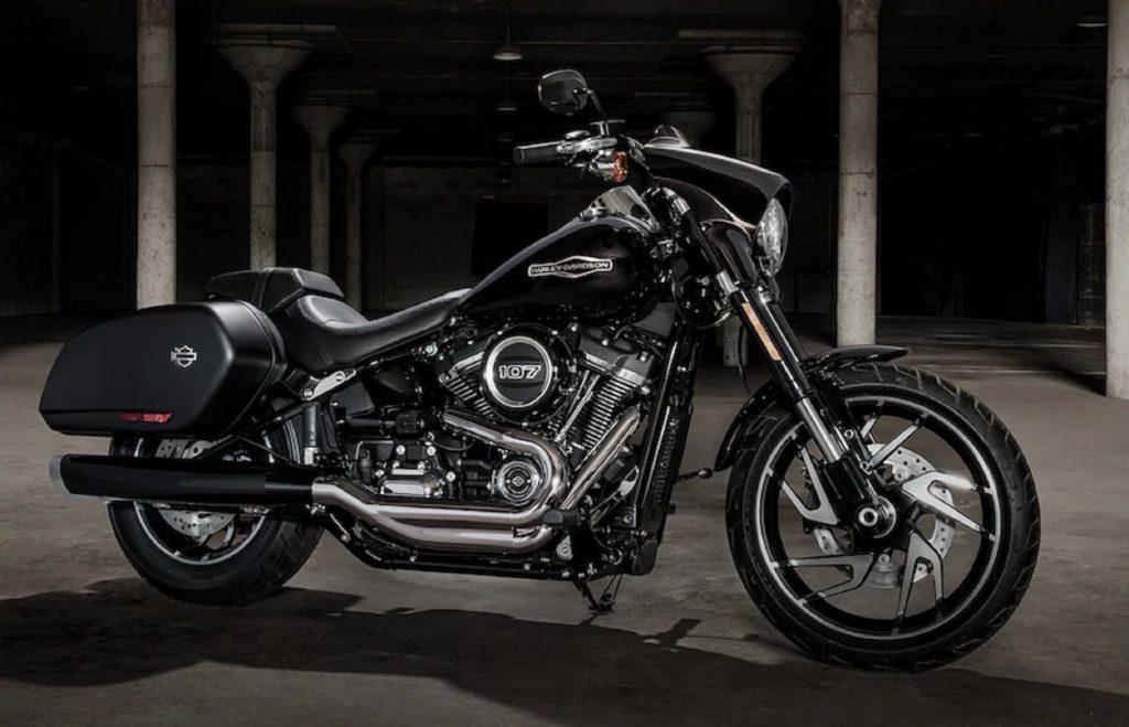 A black 2020 Harley-Davidson Sport Glide in a garage