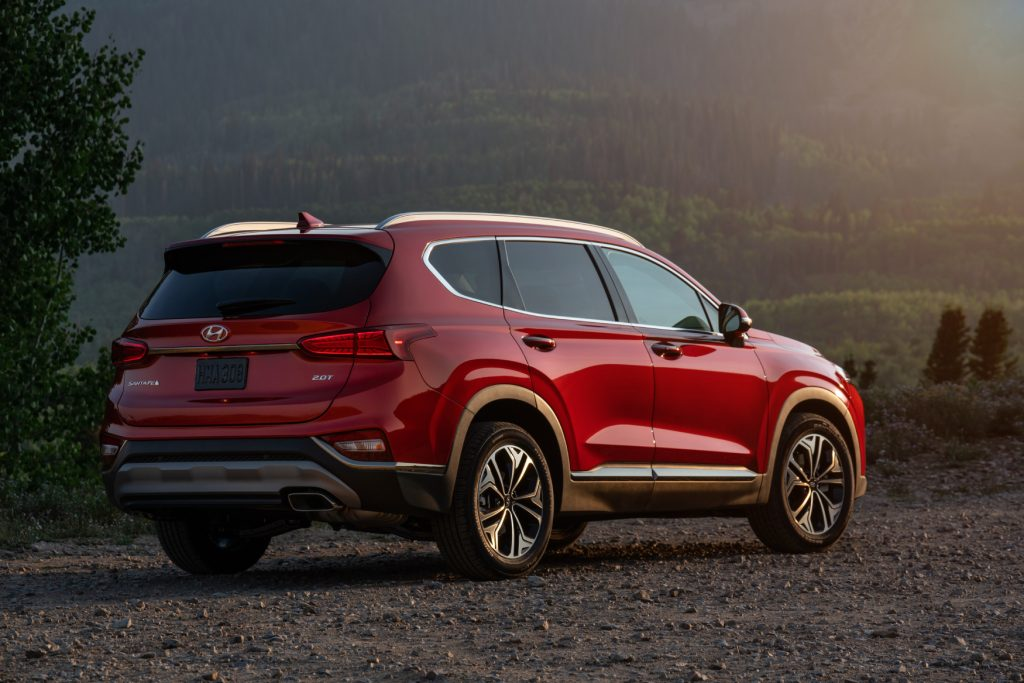 The 2020 Hyundai Santa Fe facing away, looking toward the sunset