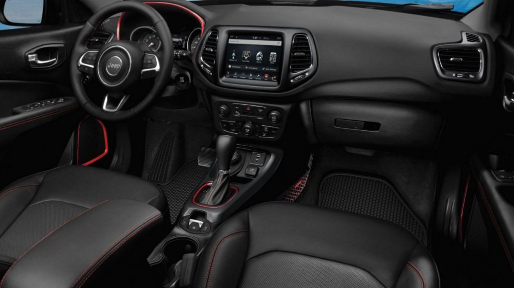 The red-trimmed black interior of the 2020 Jeep Compass Trailhawk