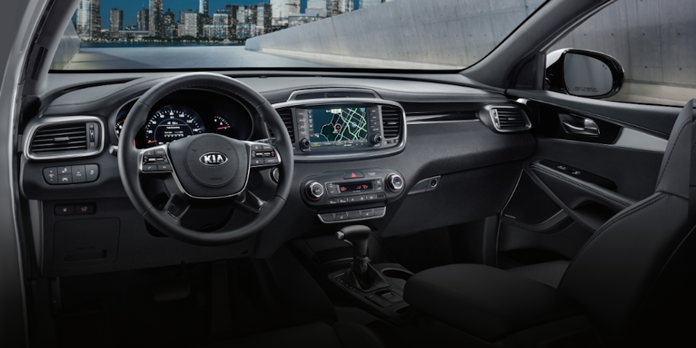 Front seats of the 2020 Kia Sorento crossover with black cloth upholstery.