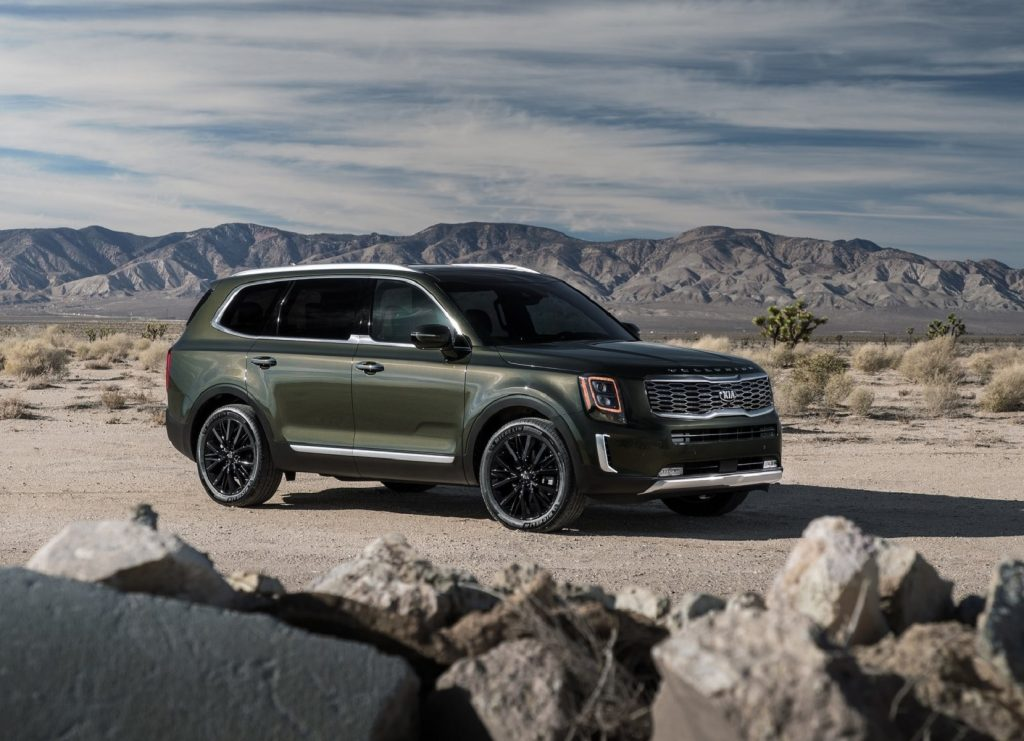 A dark-green 2020 Kia Telluride in the desert