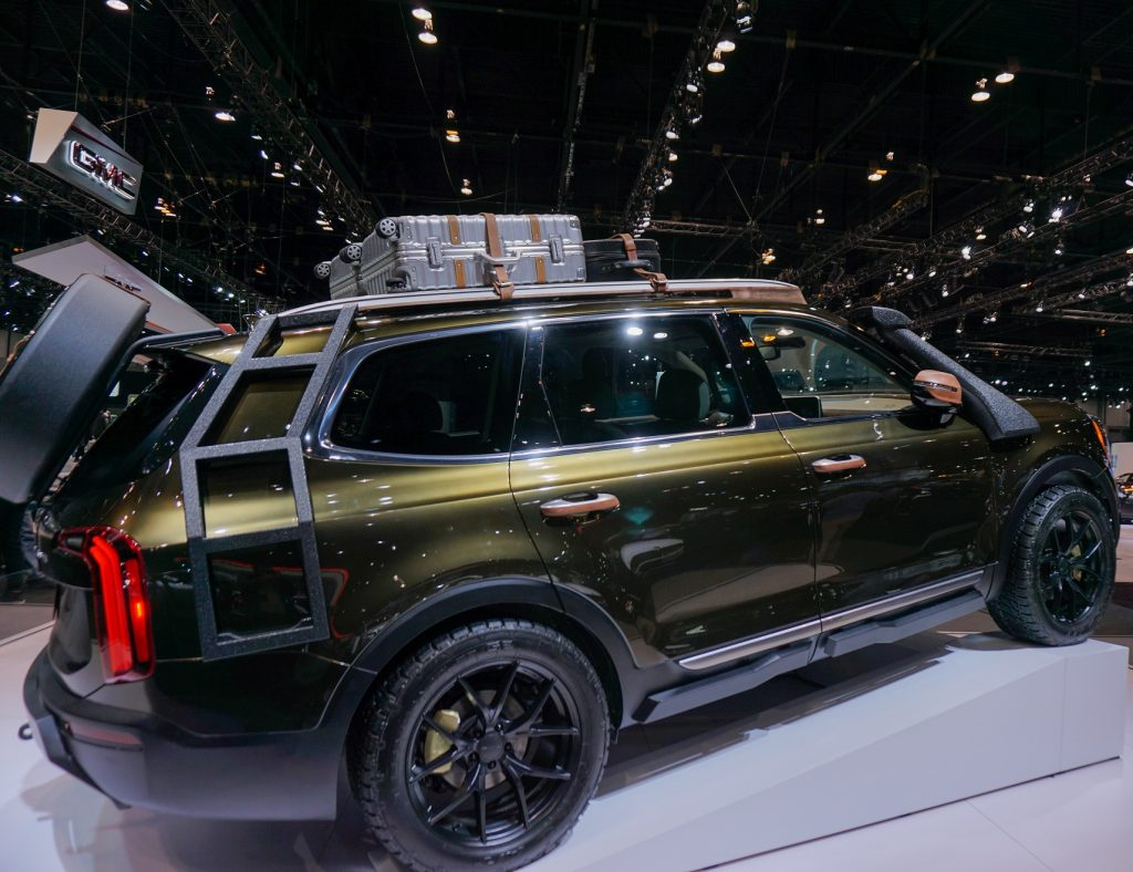 The side view of a dark-green 2020 Kia Telluride originally modified for NY Fashion Week