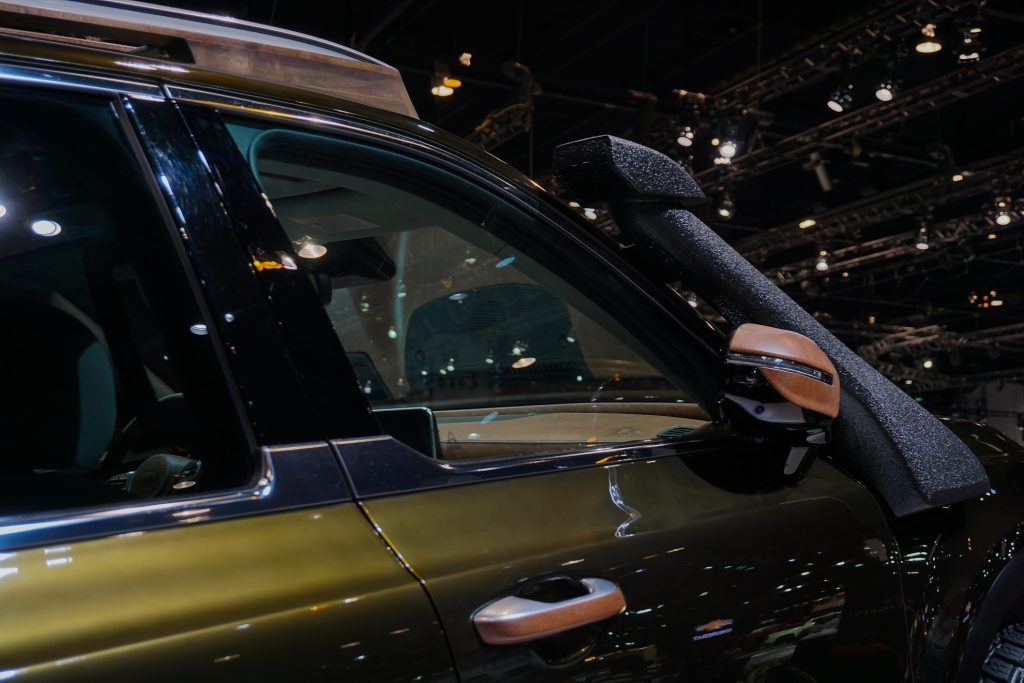 A closer look at the dark-green 2020 Kia Telluride NY Fashion Week's leather-covered mirrors and black snorkel